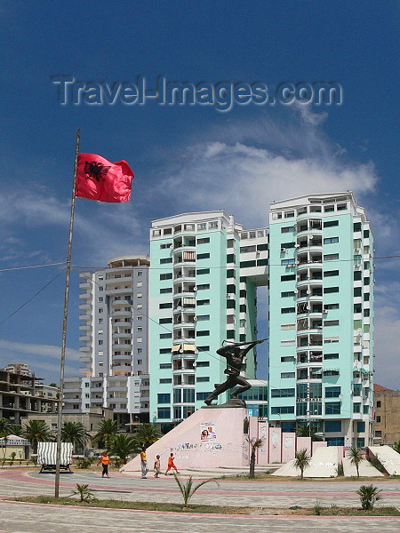 albania94: Durres / Drach, Albania: Albanian flag and apartment buildings - photo by J.Kaman - (c) Travel-Images.com - Stock Photography agency - Image Bank