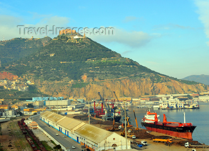 algeria188: Oran, Algeria / Algérie: harbor - Bassin d'Arzew - the freighter Artic Stream with Djebel Murdjadjo mountain in the background - photo by M.Torres | le port - Bassin d'Arzew - le navire cargo Arctic Stream avec la montagne Djebel Murdjadjo en fond - (c) Travel-Images.com - Stock Photography agency - Image Bank