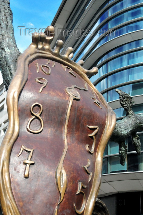 andorra48: Andorra la Vella, Andorra: bronze sculpture 'La noblesse du temps', Salvador Dalí, donated by Enric Sabater i Bonany - 'The Nobility of Time' sculpture invokes iconic 'The Persistence of Memory' painting through the soft watch on a tree, a Surrealist  meditation on the relativity of space and time - Pont de la Rotonda - photo by M.Torres - (c) Travel-Images.com - Stock Photography agency - Image Bank