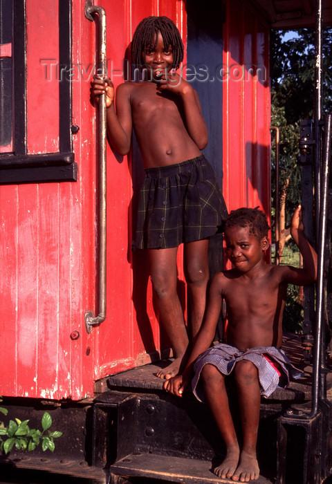 angola14: Angola - Luanda - kids near a red railroad car, their house - miúdos junto a carruagem vermelha , a sua casa - images of Africa by F.Rigaud - (c) Travel-Images.com - Stock Photography agency - Image Bank