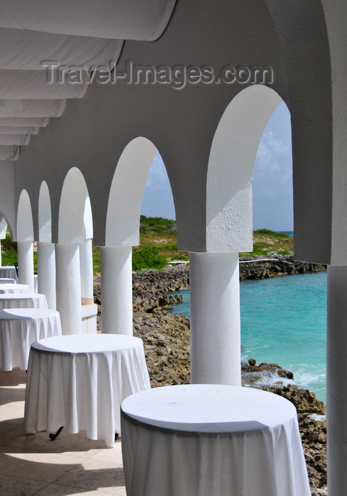 anguilla16: Maundays Bay, West End Village, Anguilla: empty tables by the sea - arcade at Cap Juluca five-star resort - photo by M.Torres - (c) Travel-Images.com - Stock Photography agency - Image Bank