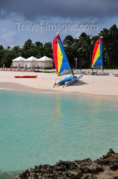 anguilla35: Maundays Bay, West End Village, Anguilla: white sand beach with turqoise water - mini-catamarans and beach gazebos - Cap Juluca five-star resort - photo by M.Torres - (c) Travel-Images.com - Stock Photography agency - Image Bank