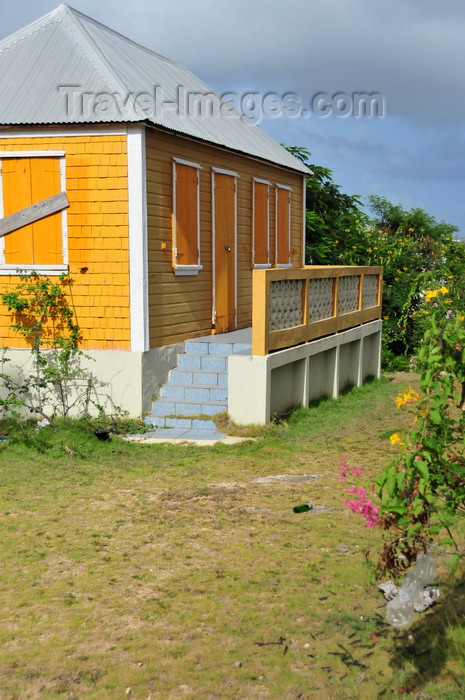 anguilla42: The Valley, Anguilla: orange cottage with zinc roof - Carribbean dwelling, Anguillean charm - photo by M.Torres - (c) Travel-Images.com - Stock Photography agency - Image Bank