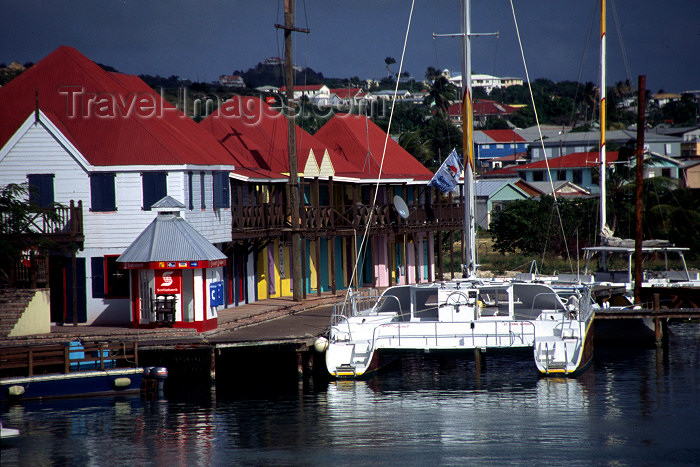 antigua-barbuda1: Antigua - St John's: catamaran under your veranda (photo by S.Young) - (c) Travel-Images.com - Stock Photography agency - Image Bank