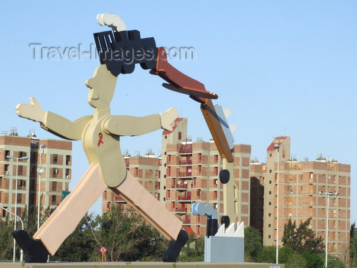 argentina194: Argentina - Córdoba - modern art - statue with AIDS ribbon against residential blocks - images of South America by M.Bergsma - (c) Travel-Images.com - Stock Photography agency - Image Bank