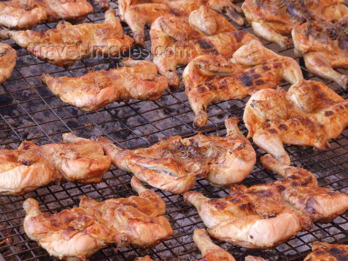 argentina237: Argentina - Puerto Iguazu - chicken BBQ - images of South America by M.Bergsma - (c) Travel-Images.com - Stock Photography agency - Image Bank