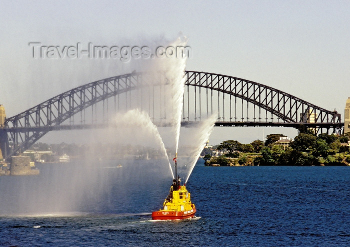 australia443: Australia - Sydney (NSW): tug boat show and Harbour Bridge - water jets (photo by A.Walkinshaw) - (c) Travel-Images.com - Stock Photography agency - Image Bank