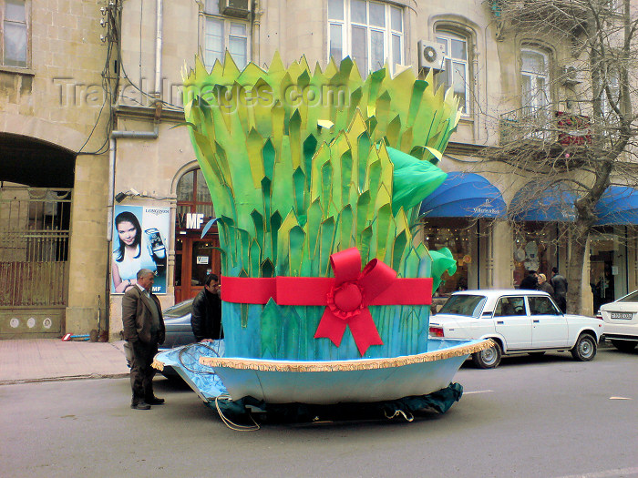 azer168: Baku, Azerbaijan: Novruz decoration in the city - a man looks at a giant Semeni, sprouting wheat - street scene - photo by N.Mahmudova - (c) Travel-Images.com - Stock Photography agency - Image Bank