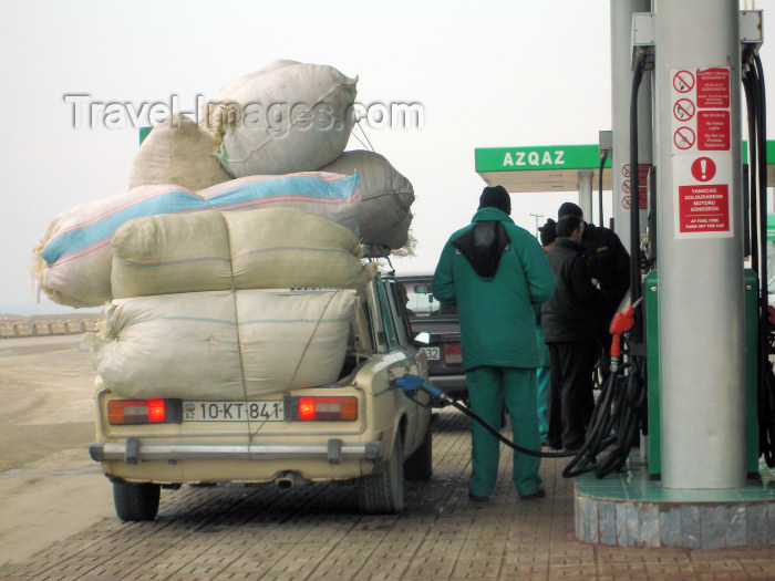 azer172: Salyan road, Azerbaijan: petrol station - overloaded car gets some gasoline - Lada - photo by F.MacLachlan - (c) Travel-Images.com - Stock Photography agency - Image Bank