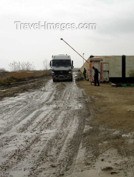 azer176: Astara, Azerbaijan: Azeri-Iranian border - main vehicle border crossing - a muddy and litter strewn track alongside the beach - lorry - Mercedes-Benz truck clears customs - photo by F.MacLachlan - (c) Travel-Images.com - Stock Photography agency - Image Bank
