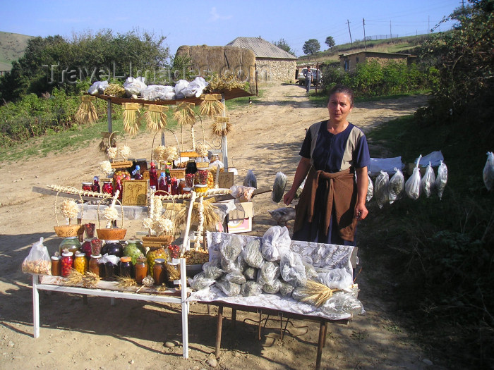 azer181: Qala Alti - Davachi rayon, Azerbaijan: lady selling pickles and herbs - photo by F.MacLachlan - (c) Travel-Images.com - Stock Photography agency - Image Bank