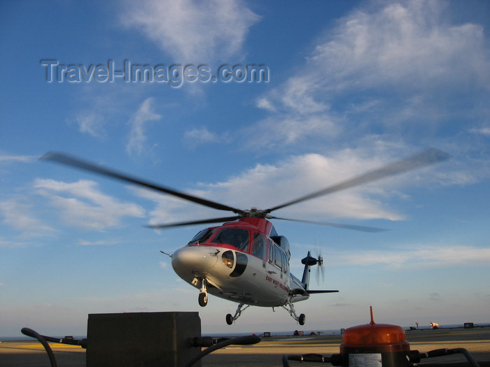 azer190: Caspian sea - Sikorsky S-76A helicopter landing on oil rig - East West Helicopters - Central Azeri section of Azeri-Chirag-Gunashli oil field - photo by L.McKay - (c) Travel-Images.com - Stock Photography agency - Image Bank