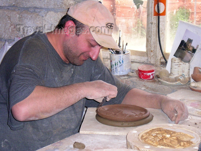 azer221: Azerbaijan - Baku: potter finishing a picture of Baku - pottery on the road to the airport - artisan - clay - photo by F.MacLachlan - (c) Travel-Images.com - Stock Photography agency - Image Bank