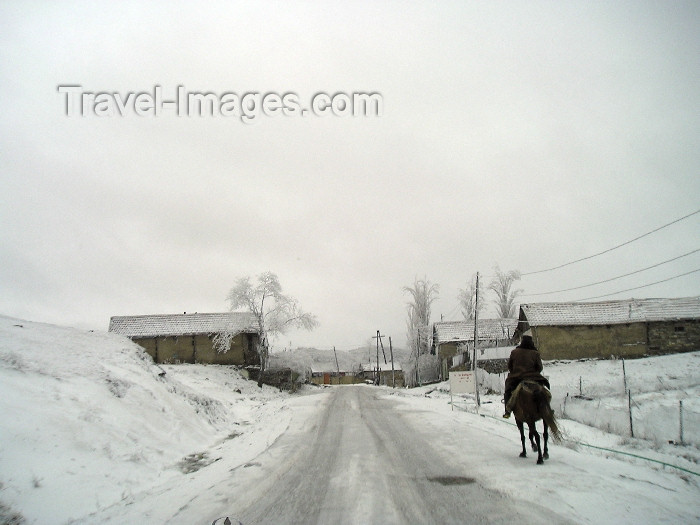 azer256: Azerbaijan - Alti Agac / Altyagach / Altyagac / Altiagach / Altiaghaj (Xizi rayon - NE Azerbaijan): on the way to Cennet Bagi Paradise Resort - winter - snow - road - horseman (photo by F.MacLachlan) - (c) Travel-Images.com - Stock Photography agency - Image Bank