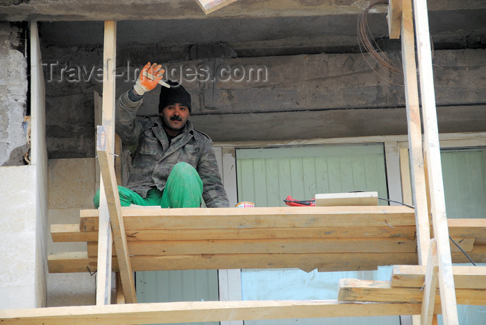 azer379: Azerbaijan - Baku: old town - friendly builder on a shaky scaffold - construction worker - construction site - photo by M.Torres - (c) Travel-Images.com - Stock Photography agency - Image Bank