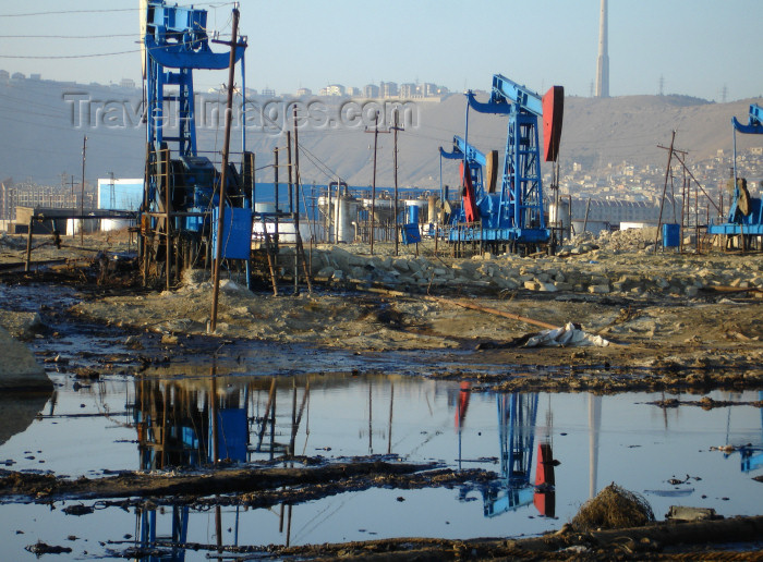 azer428: Baku - Azerbaijan: oil contamindated soil and pumpjacks near the harbour, below Bibi Heybat Mosque - pollution - photo by F.MacLachlan - (c) Travel-Images.com - Stock Photography agency - Image Bank