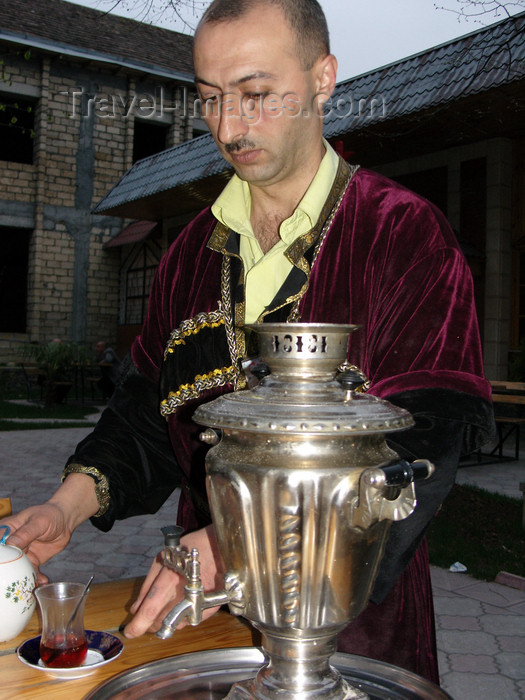 azer436: Sheki / Shaki - Azerbaijan: man in Caucasian garb serves tea - samovar - photo by N.Mahmudova - (c) Travel-Images.com - Stock Photography agency - Image Bank