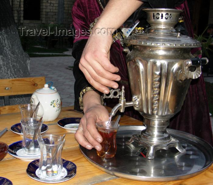 azer437: Sheki / Shaki - Azerbaijan: serving tea, Azeri style - armud glasses and samovar - photo by N.Mahmudova - (c) Travel-Images.com - Stock Photography agency - Image Bank