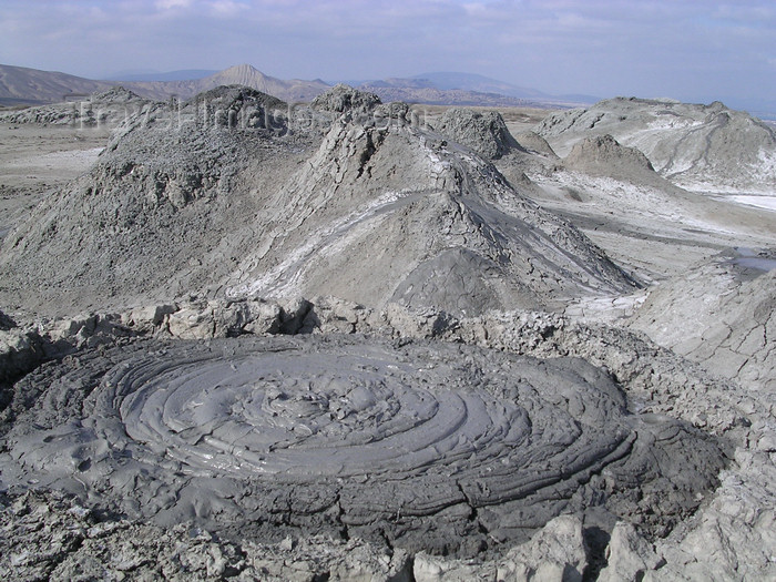 azer514: Gobustan, Azerbaijan - Qobustan Rayonu: mud volcano - small eruption and  mud volcano skyline - photo by G.Monssen - (c) Travel-Images.com - Stock Photography agency - Image Bank