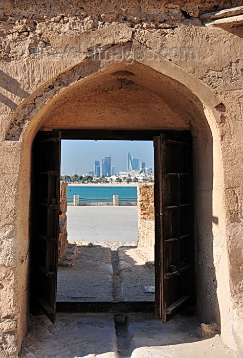 bahrain2: Arad, Muharraq Island, Bahrain: Arad Fort - view of the Al Manama skyline through the fort's main gate - photo by M.Torres - (c) Travel-Images.com - Stock Photography agency - Image Bank