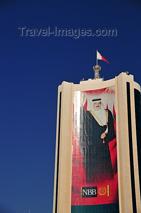 bahrain42: Manama, Bahrain: the King's image at thr National Bank of Bahrain building - Hamad bin Isa Al Khalifa personality cult - Abbey, Hanson, Rowe and Partners architects - photo by M.Torres - (c) Travel-Images.com - Stock Photography agency - Image Bank
