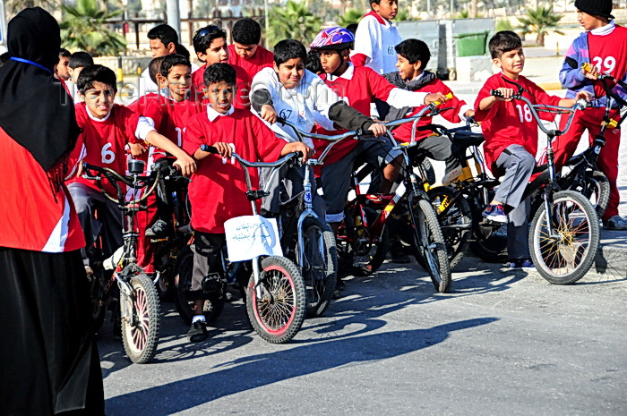 bahrain78: Arad, Muharraq Island, Bahrain: children at the start line for a bike race - photo by M.Torres - (c) Travel-Images.com - Stock Photography agency - Image Bank