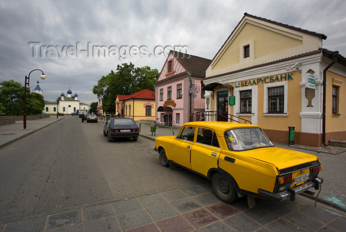 belarus103: Mir, Karelicy raion, Hrodna Voblast, Belarus: yellow car, bank, street and Orthodox church of the Holy Trinity - photo by A.Dnieprowsky - (c) Travel-Images.com - Stock Photography agency - Image Bank
