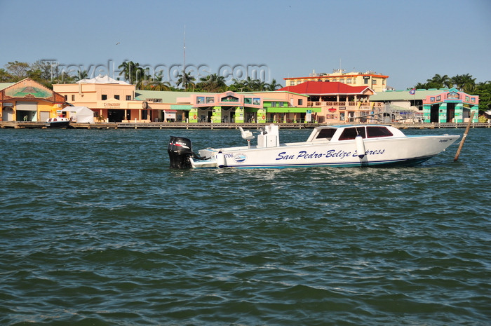 belize108: Belize City, Belize: boat used in San Pedro-Belize express service - shops and bars of Belize City Tourism Village and Radisson Fort George - mouth of Haulover Creek - photo by M.Torres - (c) Travel-Images.com - Stock Photography agency - Image Bank