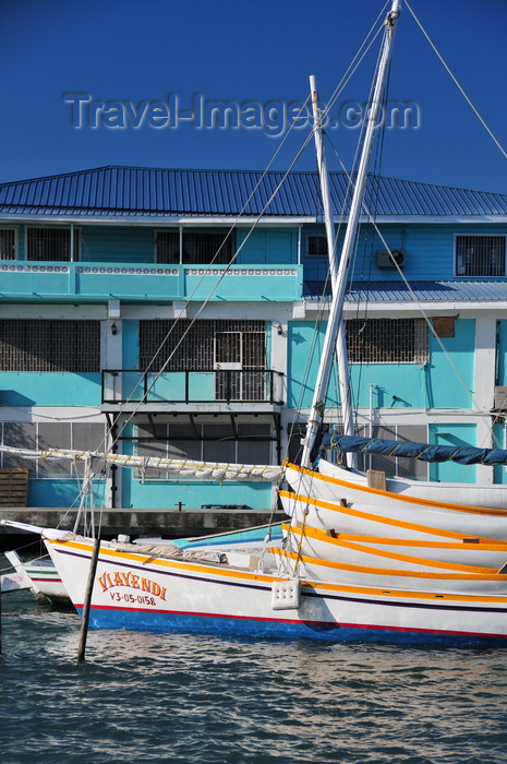 belize111: Belize City, Belize: mouth of Haulover Creek - house and boat Viayendi loaded with canoes - photo by M.Torres - (c) Travel-Images.com - Stock Photography agency - Image Bank