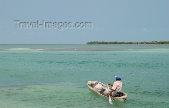 belize43: Belize - Caye Caulker - Ambergris Caye: me, my God, my dreams - canoe - lonely fisherman on the caribean sea - Caribbean Sea - photo by C.Palacio - (c) Travel-Images.com - Stock Photography agency - Image Bank