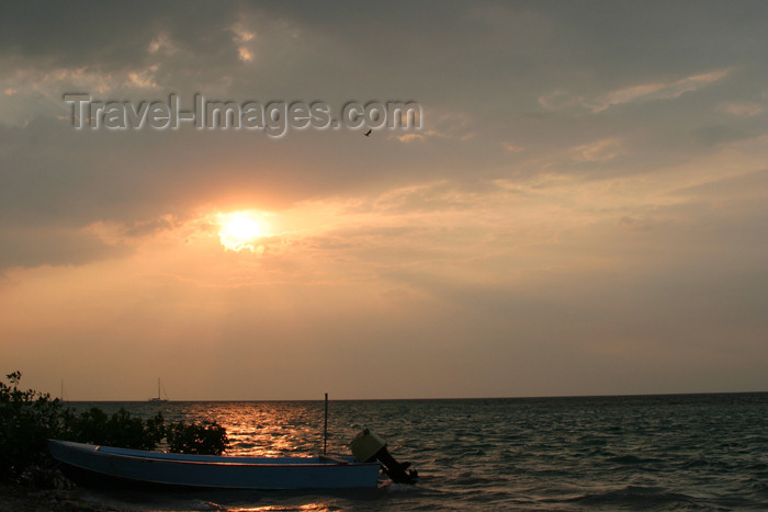 belize60: Belize - Seine Bight, Placencia peninsula, Stann Creek District: boat at sunset - photo by Charles Palacio - (c) Travel-Images.com - Stock Photography agency - Image Bank