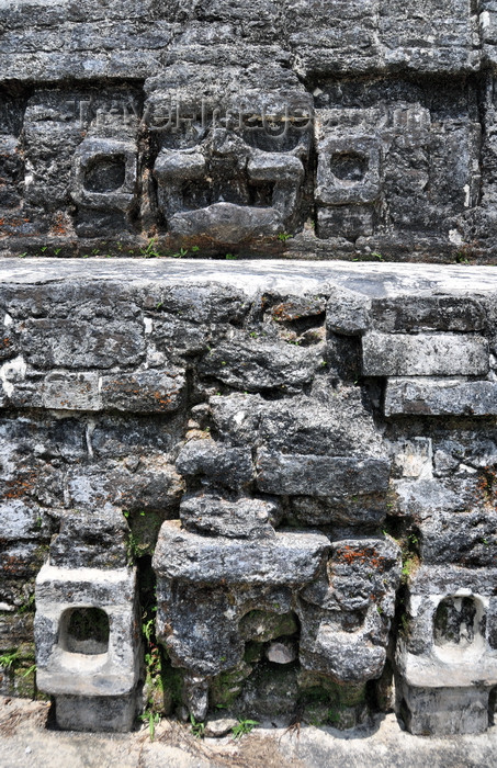 belize85: Altun Ha Maya city, Belize District, Belize: Temple of the Masonry Altars, stone masks of Mayan gods decorate the SW corner - photo by M.Torres - (c) Travel-Images.com - Stock Photography agency - Image Bank