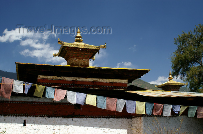 bhutan108: Bhutan - Paro dzongkhag - Bhuddist prayer flags and the roof of Kyichu Lhakhang, near Paro - photo by A.Ferrari - (c) Travel-Images.com - Stock Photography agency - Image Bank