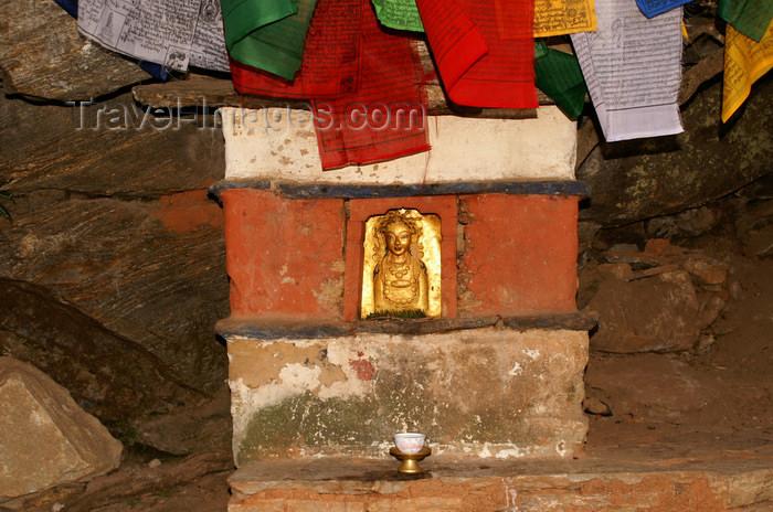 bhutan139: Bhutan - Paro dzongkhag - Golden figure and prayer flags, outside Taktshang Goemba - photo by A.Ferrari - (c) Travel-Images.com - Stock Photography agency - Image Bank