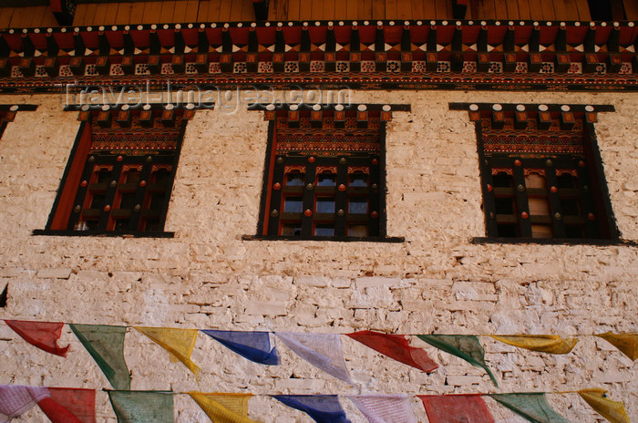 bhutan140: Bhutan - Paro dzongkhag - Prayer flags, in front of the walls of Taktshang Goemba - photo by A.Ferrari - (c) Travel-Images.com - Stock Photography agency - Image Bank
