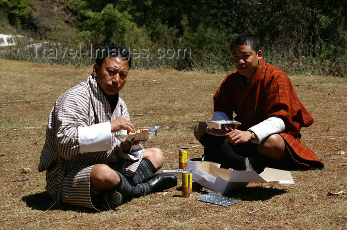 bhutan156: Bhutan - Haa valley - Lunch time - wearing a gho - photo by A.Ferrari - (c) Travel-Images.com - Stock Photography agency - Image Bank