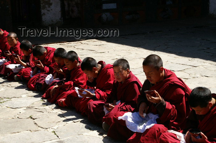 bhutan161: Bhutan - line of monks having lunch, in Haa Trasang - photo by A.Ferrari - (c) Travel-Images.com - Stock Photography agency - Image Bank