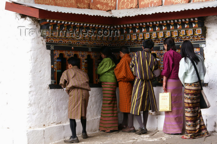 bhutan239: Bhutan - Bhutanese people rolling prayer wheels, in Chari Goemba - photo by A.Ferrari - (c) Travel-Images.com - Stock Photography agency - Image Bank