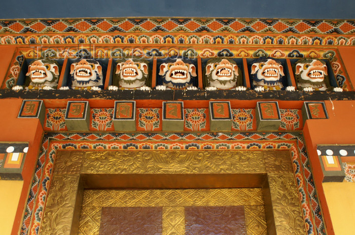 bhutan290: Bhutan - Scary faces carved in wood, in Khansum Yuelley Namgyal Chorten - gate - photo by A.Ferrari - (c) Travel-Images.com - Stock Photography agency - Image Bank