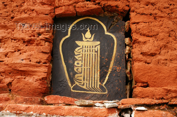 bhutan310: Bhutan - Buddhist symbol in the main wall of the Chendebji Chorten - photo by A.Ferrari - (c) Travel-Images.com - Stock Photography agency - Image Bank
