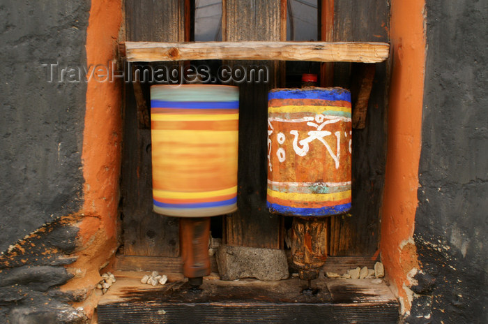 bhutan326: Bhutan - Jampa Lhakhang - Bumthang valley - two prayer wheels, one spinning - photo by A.Ferrari - (c) Travel-Images.com - Stock Photography agency - Image Bank