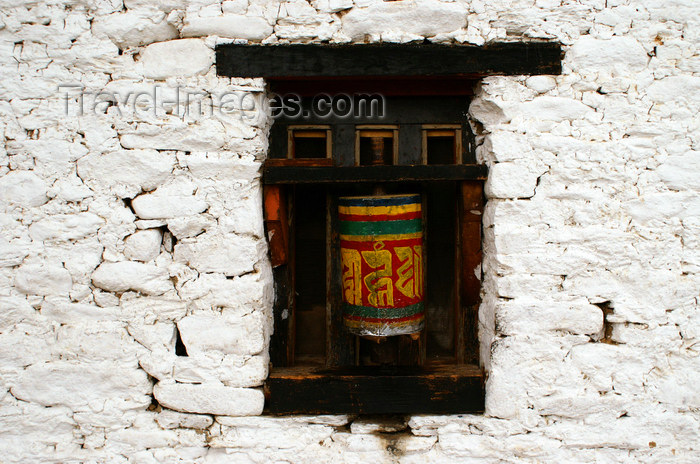 bhutan329: Bhutan - Jampa Lhakhang - white wall with prayer wheels - photo by A.Ferrari - (c) Travel-Images.com - Stock Photography agency - Image Bank