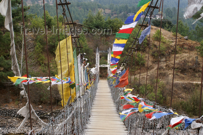 bhutan342: Bhutan - Kurjey Lhakhang - suspension bridge with prayer flags - photo by A.Ferrari - (c) Travel-Images.com - Stock Photography agency - Image Bank