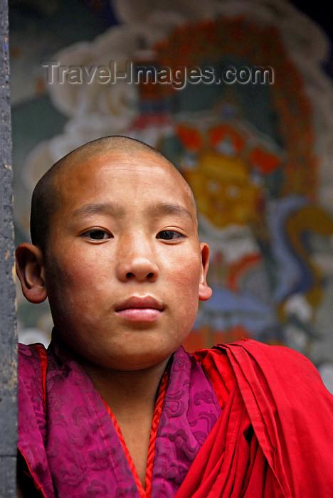bhutan404: Bhutan, Paro, Young Monk in Paro Dzong - photo by J.Pemberton - (c) Travel-Images.com - Stock Photography agency - Image Bank
