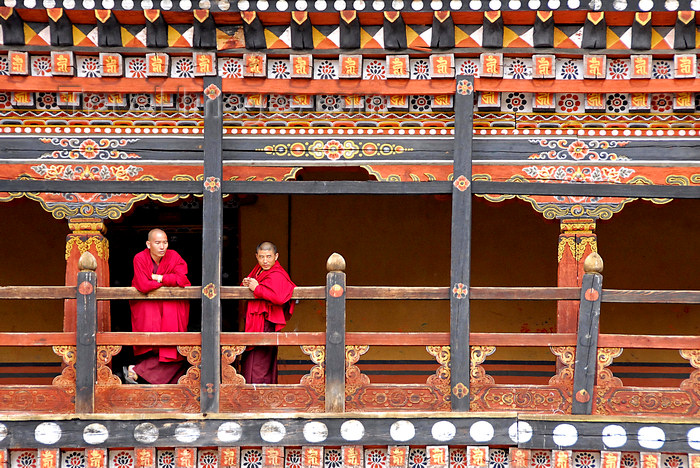 bhutan410: Bhutan, Paro, Monks on balcony of inner courtyard of Paro Dzong - photo by J.Pemberton - (c) Travel-Images.com - Stock Photography agency - Image Bank