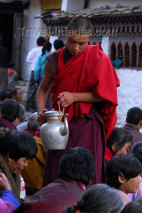 bhutan414: Bhutan, Paro, a monk distributes tea to pilgrims - photo by J.Pemberton - (c) Travel-Images.com - Stock Photography agency - Image Bank