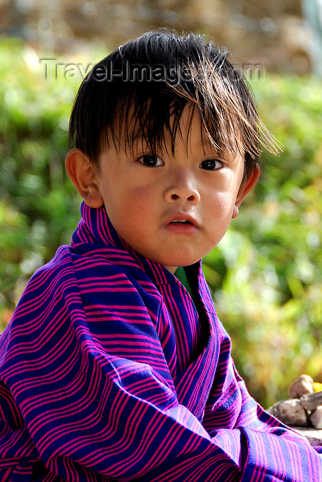 bhutan415: Bhutan, Paro, Young boy in traditional dress - photo by J.Pemberton - (c) Travel-Images.com - Stock Photography agency - Image Bank