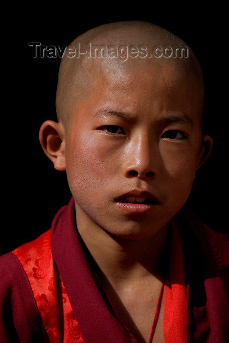 bhutan416: Bhutan, Paro,Young monk in Paro Dzong - photo by J.Pemberton - (c) Travel-Images.com - Stock Photography agency - Image Bank