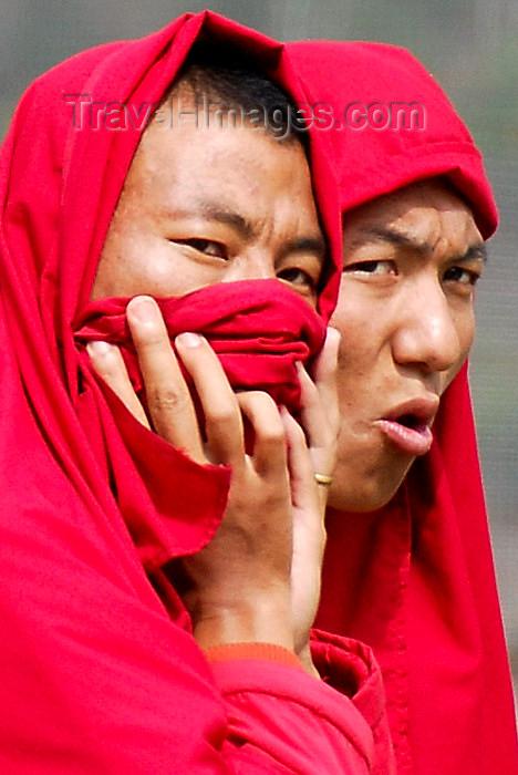 bhutan422: Bhutan, Thimphu, Monks watching archery contest - photo by J.Pemberton - (c) Travel-Images.com - Stock Photography agency - Image Bank