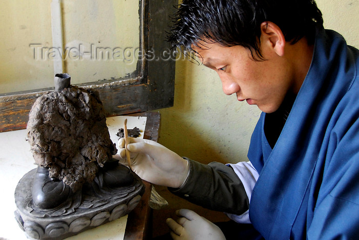 bhutan431: Bhutan, Thimpu, Student crafting statue at National Technical Training Institute - photo by J.Pemberton - (c) Travel-Images.com - Stock Photography agency - Image Bank